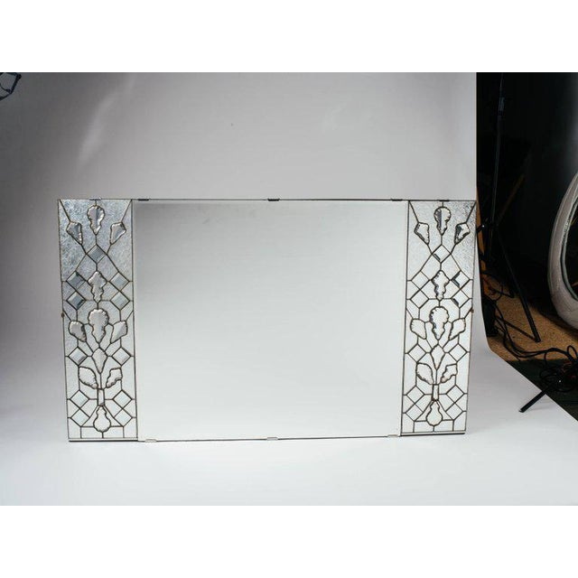 Exquisite 1940s Hollywood Regency Art Deco rectangular mirror. Features transparent stained glass panels on either side,...