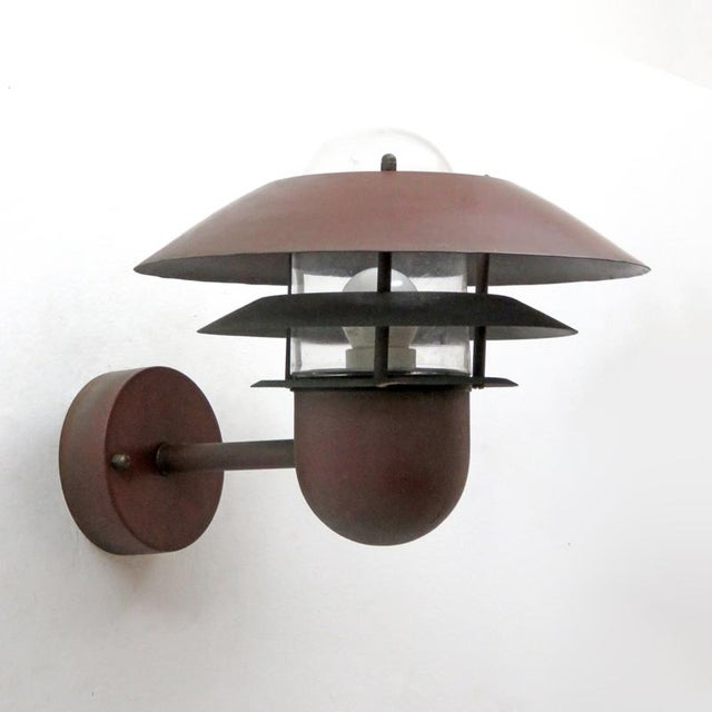 great pair of Danish outdoor wall sconces by Nordlux in copper with glass bulb enclosures priced as a set
