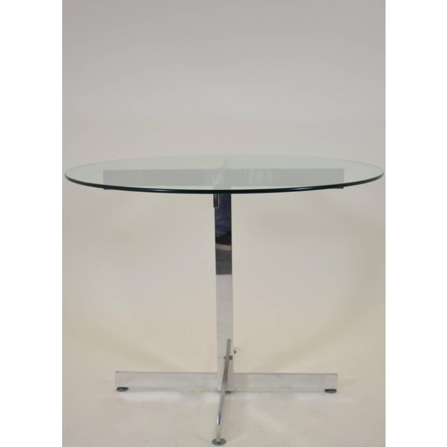 Perfect for a small dining or breakfast area; could even be a center or game table. Highly polished simple aluminum base...
