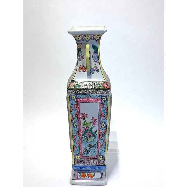 A large Chinese Famille Rose square vase with brightly coloured painted enamel scenes of birds flying amongst trees and...