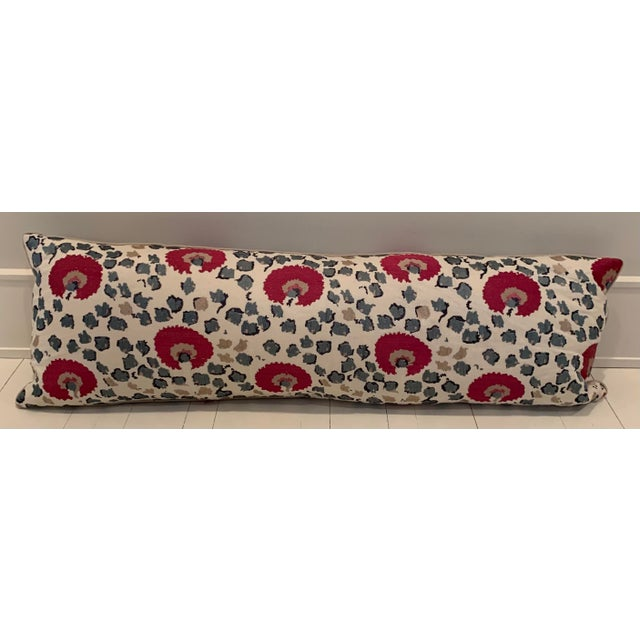 Embroidered Vaughn fabric bolster. Knife edge contrast welt with a down feather insert.