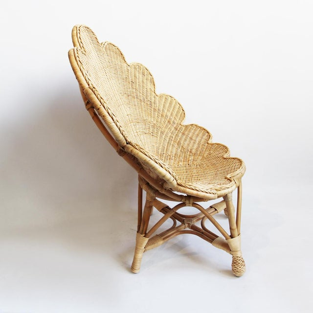 Hand woven rattan shell shaped occasional chair in natural raw finish. Beautiful and fun seating option for indoors or...
