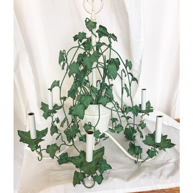 Fantastic 1960s metal painted green and white tole chandelier with six arms, decorated with trailing ivy vines around a...