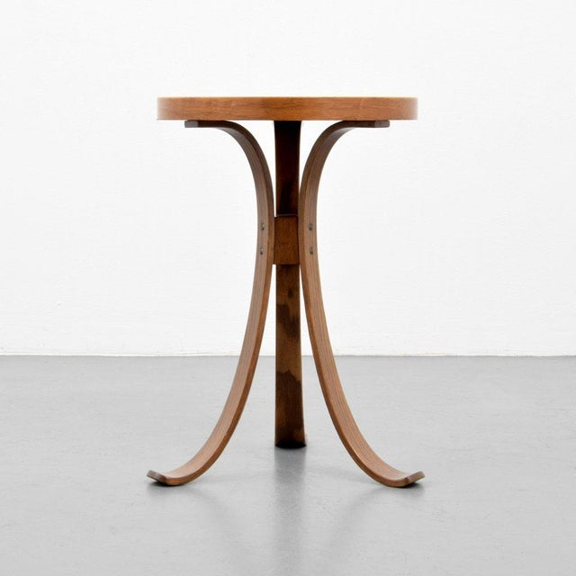Dunbar Constellation Table by Edward Wormley. Sculptural wood frame with a laminated top.