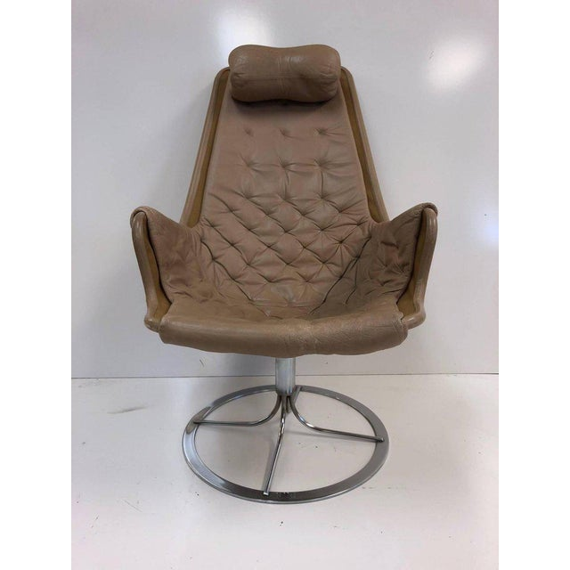 Pair of Bruno Mathsson, Jetson lounge chairs for DUX. Chairs are tufted. Original leather upholstery with a cushioned...