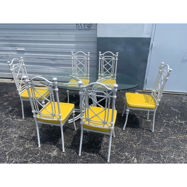 Oh so Palm Beach! Vintage 1970's wrought iron faux bamboo patio set by Kessler Industries. Oval thick glass top table with...