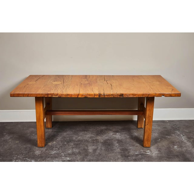 Solid, rare molave wood table, with rustic aging and hexagonal cutouts on the top. Four straight legs and stretcher bar.