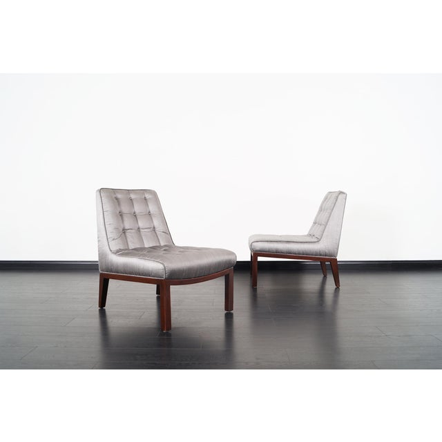 Beautiful pair of vintage slipper chairs designed by Edward J. Wormley for Dunbar. Upholstery is a metallic silver silk...
