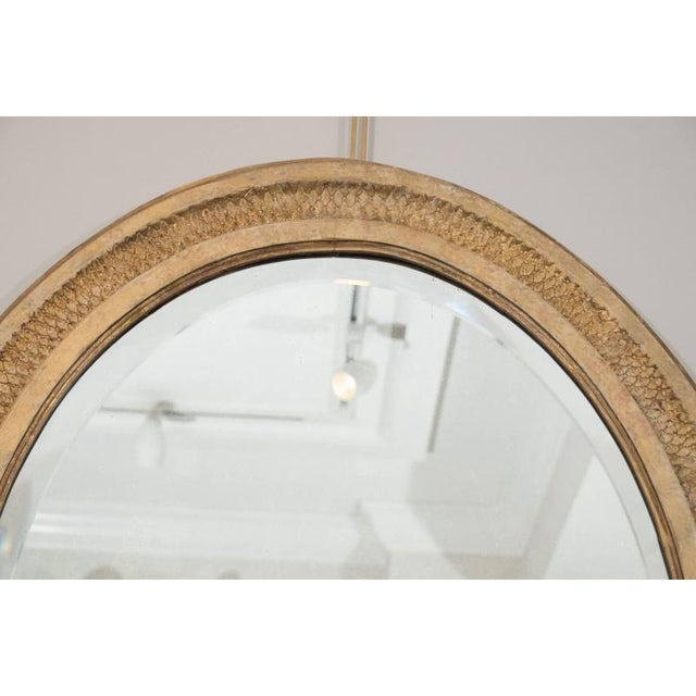 This mirror is a standout in terms of quality and workmanship. The oval beveled glass plate is set within a conforming...