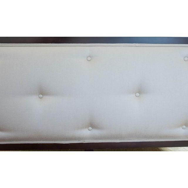 This Century Furniture queen Omni bed features an upholstered headboard and footboard, with solid wood side rails. An...
