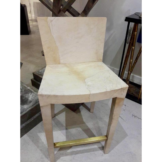 Karl Springer vintage parchment bar stool has a glamorous and eclectic mix of contemporary and 20th century design.