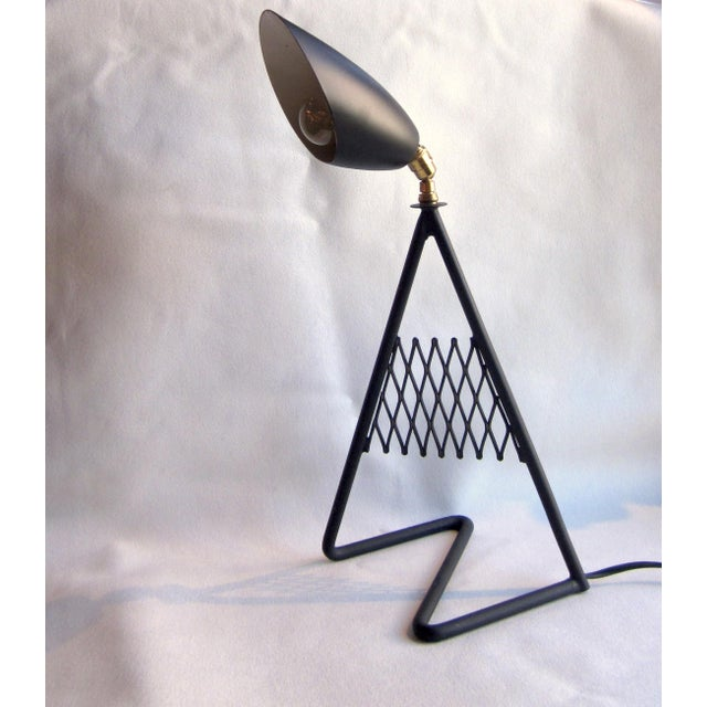 This is a sleek, elegant, and funky matte black aluminum French vintage MCM table lamp. It features an amazing zig-zag...