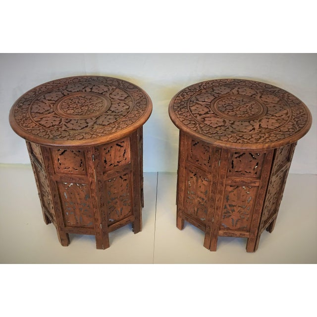These intricately hand carved rosewood side tables are in excellent vintage condition. The tops are removable allowing the...
