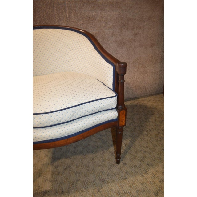 Sheraton Style Barrel Back Chair is white w/blue specs and wood trim. This chair is in very good clean condition. The...
