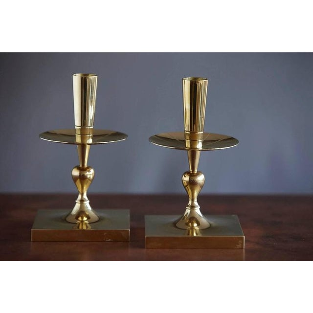 Elegant pair of Tommi Parzinger solid brass candleholders made by Dorlyn Silversmiths New York, manufacturers hallmark...
