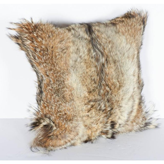 Custom ultra luxe square throw pillows handcrafted of coyote fur in hues of, tan, camel, ivory and brown, with the...