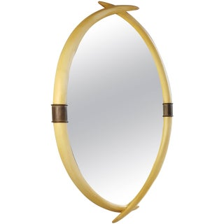 Hollywood Regency Brass and Faux Ivory Tusk Wall Mirror by Chapman 1976 For Sale