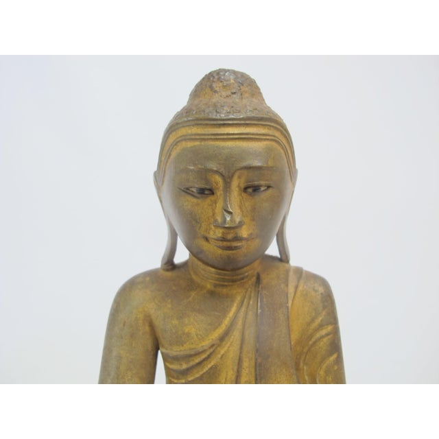 """19th century Mandalay period Buddha gilt bronze measures 11"""" tall x 8"""". Very good condition with chip at bridge of nose."""
