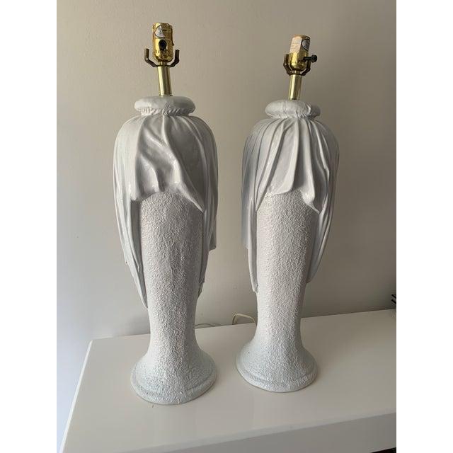 "Vintage, plaster draped, tromp l'oeil, table lamps in the manner of John Dickenson. Plaster body 22.5"" high."