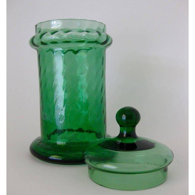 1960s green optic art glass lidded jar/apothecary by Empoli, Italy. Small chip on interior rim of lid, as shown in photo.