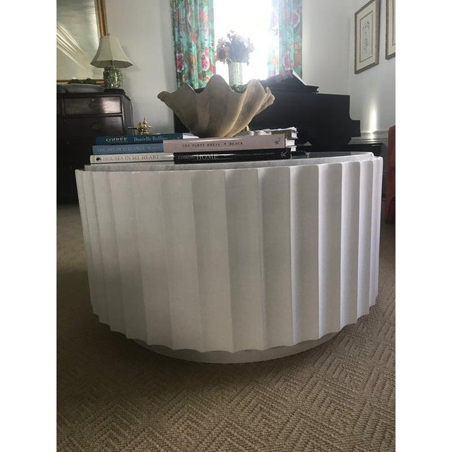 New World's Away clove coffee table-retail of $3300 White lacquer scalloped round coffee table with white marble top....