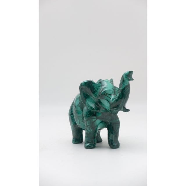 The malachite for this carving was sourced from the Congo where the finest quality of this mineral is currently found....