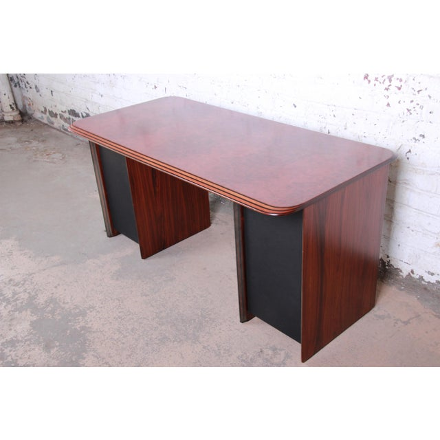 A stunning Italian desk designed by Afra and Tobia Scarpa for B&B Italia, circa 1975. The desk features a gorgeous burl...