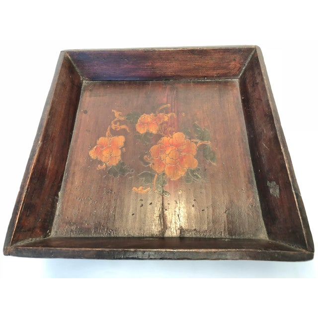 This is a vintage Chinese tray from the 1940s. The piece is dark brown and feature a hand painted floral design.