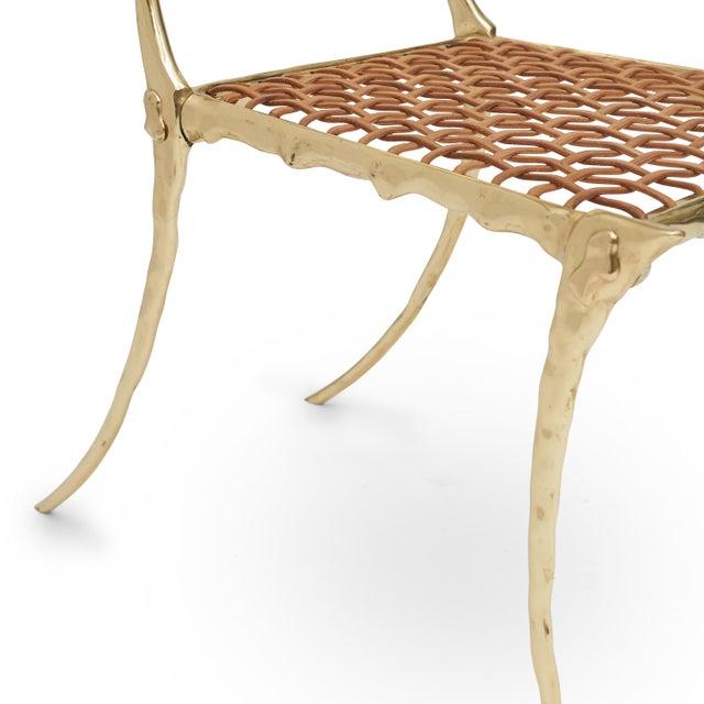 Aqua Brass Klismos Chair The Aqua Brass Klismos Chair by Sylvan S.F. is a contemporary take on the classic Klismos Chair....