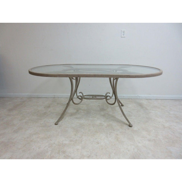 A Woodward outdoor dining table. Great shape. Shows some paint wear and scratches... some minor scratches on glass. Please...