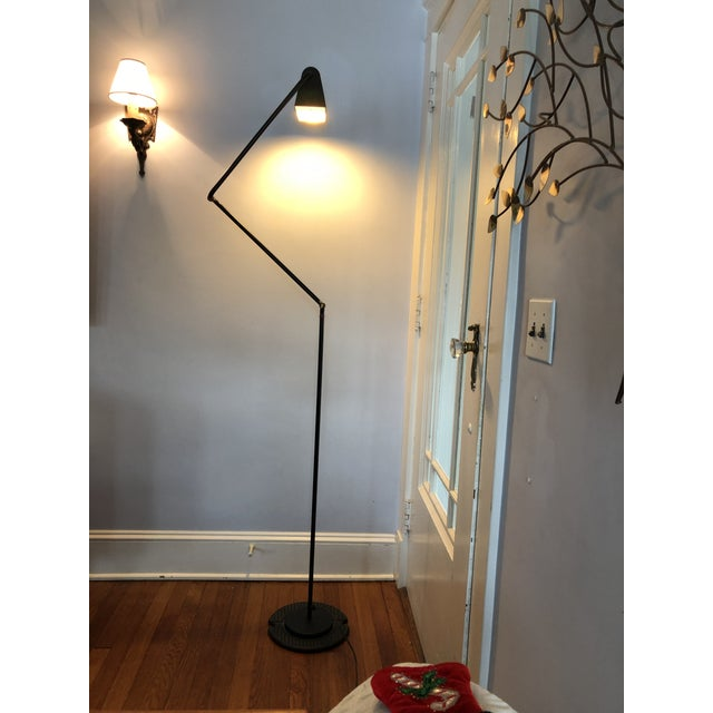 Belux floor lamp, Spain, black enameled metal, articulated arm with two adjustment points with red trim, original finish,...