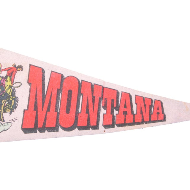 Charming and rare felt flag pennant of Montana, circa the 1950s, featuring a fabulous graphic of a cowboy on horse, with...