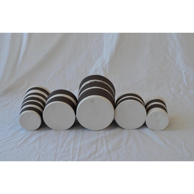 This is a set of 5 cylindrical vessels exteriors are glazed with yummy matte satin ebony (deep chocolate/black) stripes on...