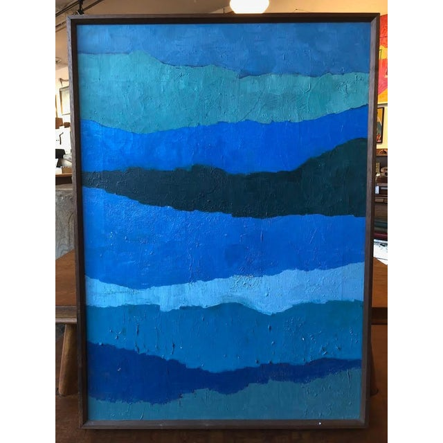 Stunning abstract painting with thick paint application in a wood frame.