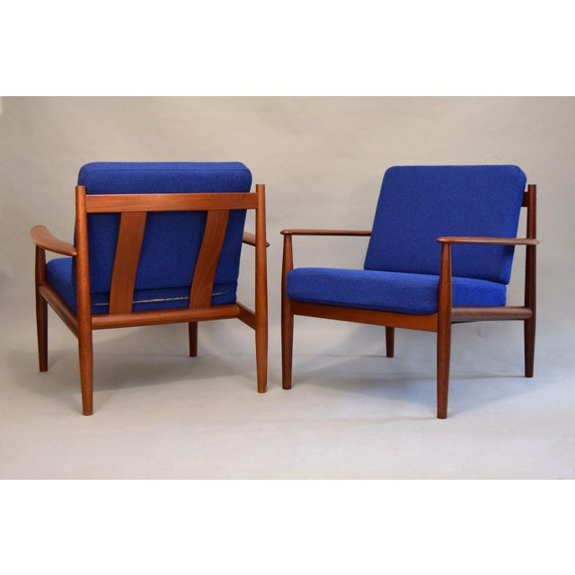 We are very pleased to offer this rare find: a stunning pair of solid teak lounge chairs designed by Grete Jalk, produced...