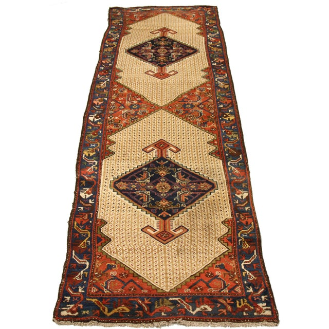 Made of the finest wool and vegetable dyes, this antique Persian rug follows a design made popular by weavers in the...