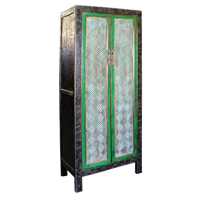 This is a tall storage dresser wardrobe cabinet with distressed crackle pattern black color frame and relief carved bar...