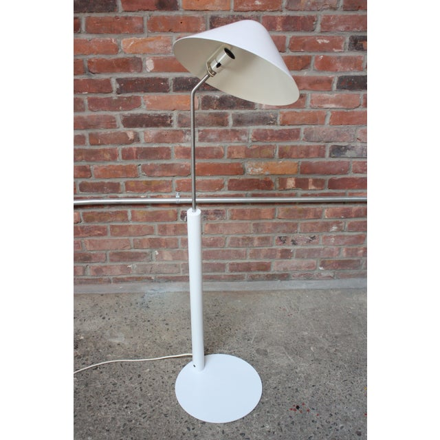 Jørgen Gammelgaard early production VIP floor lamp, circa 1983, composed of a wide, swiveling painted-aluminum shade with...