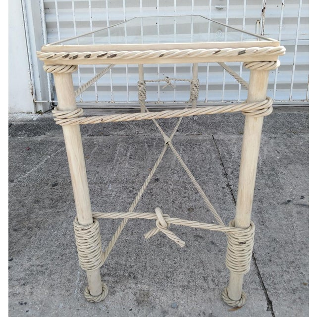 This is a beautiful vintage, wrought iron console table with a glass top. The table looks like it is all lashed together...