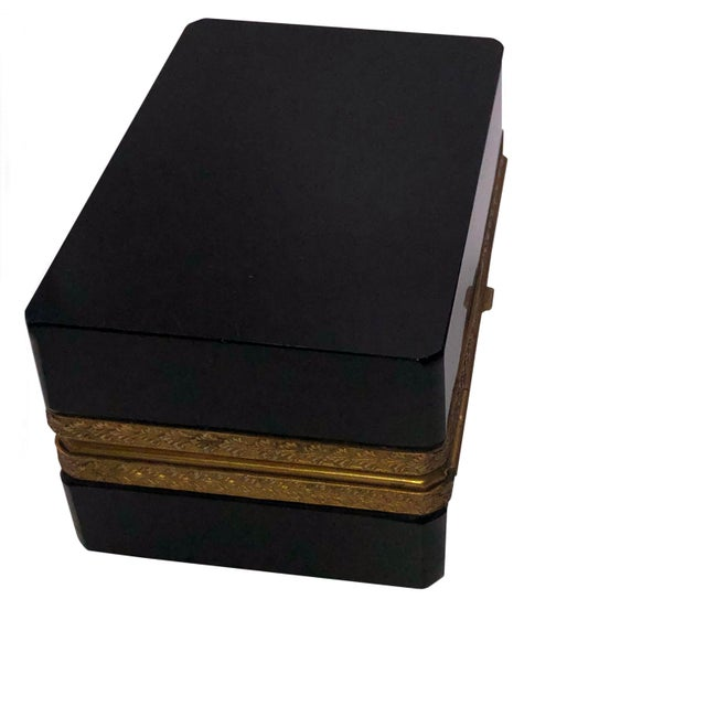 A 19th century French black opaline glass casket box with ormolu mounts and a hinged top.