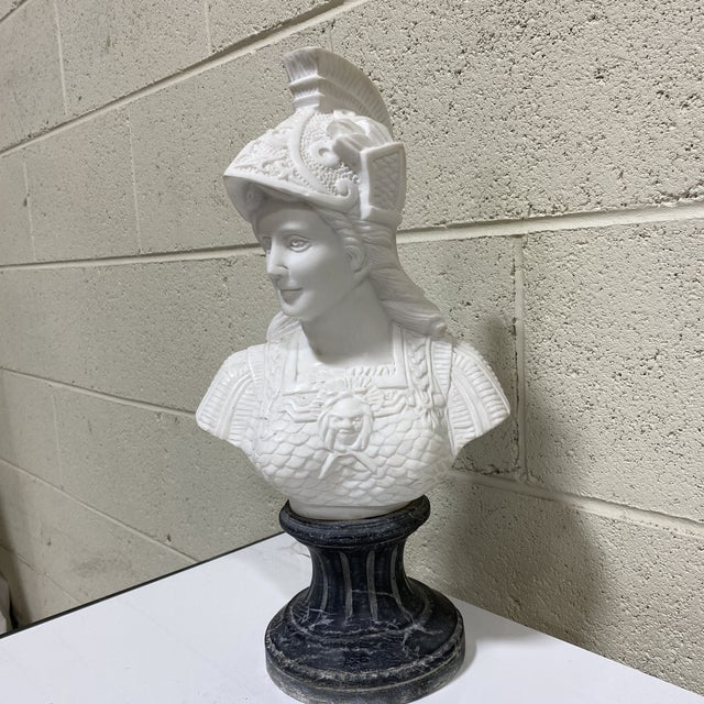 This is a beautiful solid hand carved marble white bust of Athena perched on a black and white veined marble column base....