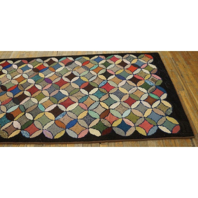 Antique American Hooked Rug with a multi colored background