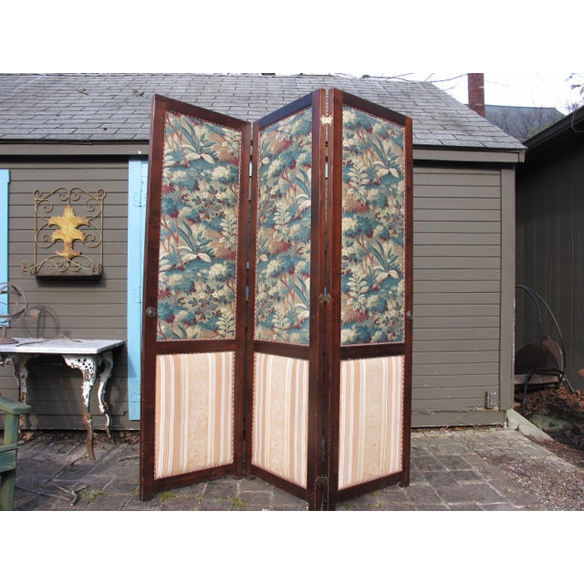 A 3-panel folding screen that has been upholstered in 19th century French printed fabrics.