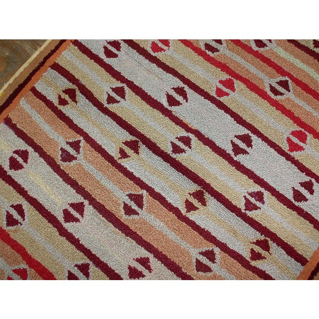 Handmade antique American hooked rug in good condition. The rug has been made in geometric design. Repeating diamond...
