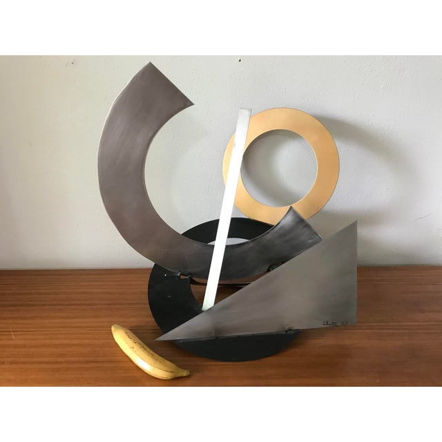 Amazing post modern abstract mixed metal sculpture, signed and dated. Beautiful composition of shapes and mixed metals.