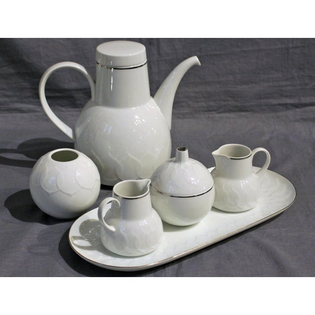 A stunning china service of Lotus White by Rosenthal, Studio-Line, c. 1975 (produced 1972-92). Molded lotus blossoms with...