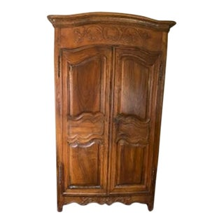 Vintage French Country Walnut Armoire with Carved Flowers For Sale