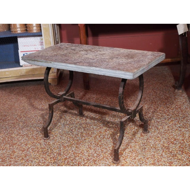 Coffee table, circa 1940, wrought iron base and stone plateau