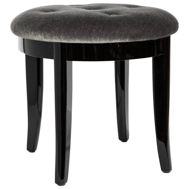 Art Deco vanity stool in a luxurious charcoal mohair with a black lacquered finish. The stool features a round seat design...