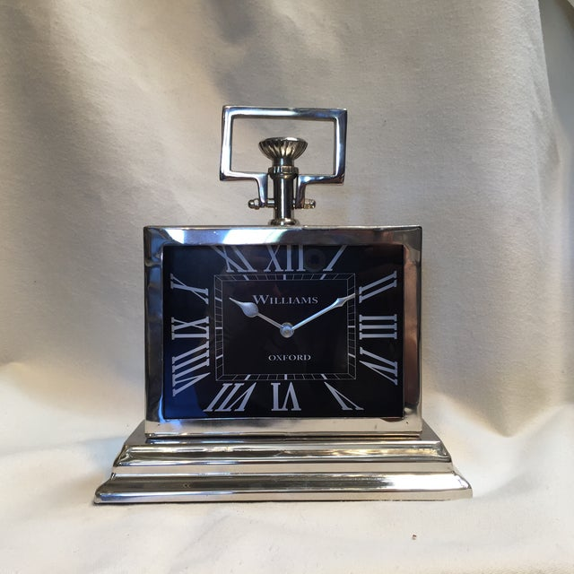 A beautiful, Classic black, rectangle face clock with white roman numerals. So that you can see across the room! Very glam...